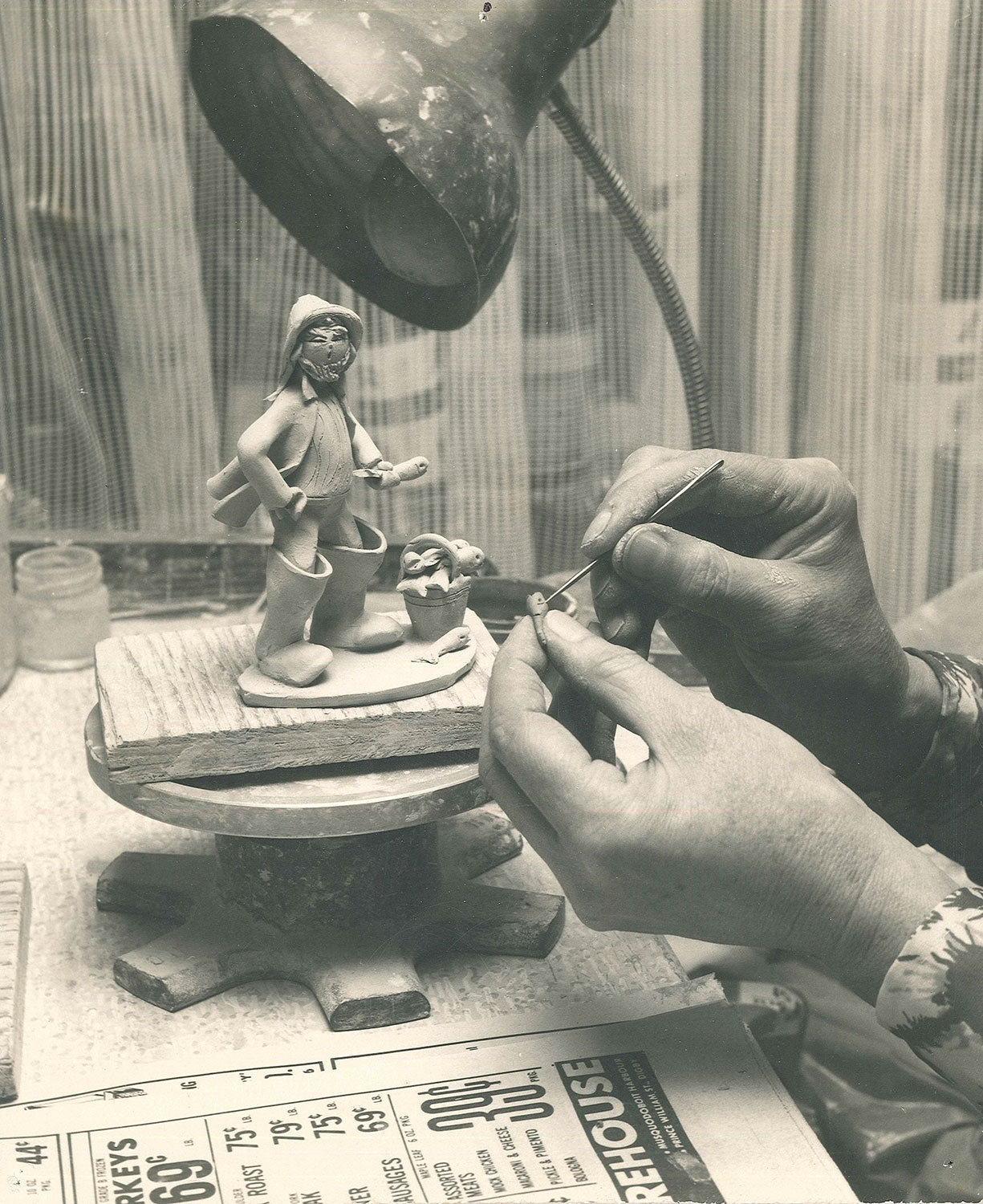 Elfreide's hands making figurine